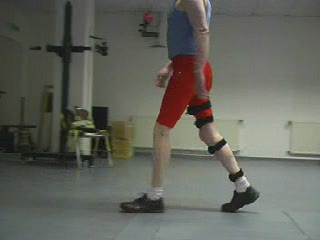 Man walking with Freewalk Stance Control KAFO